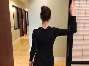 stretches in doorway